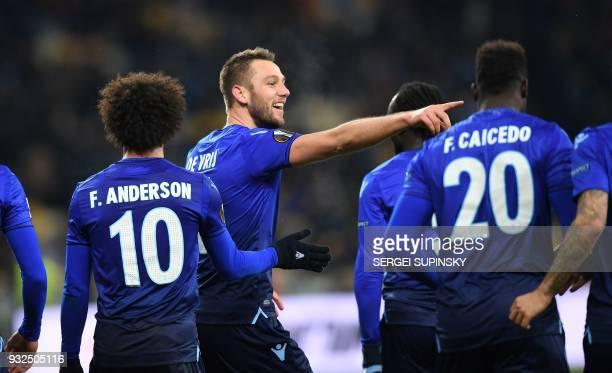 Lazios Stefan de Vrij celebrates his scoring during UEFA Europa League round 16 secondleg football match FC Dynamo Kiev vs SS Lazio Rome at the...