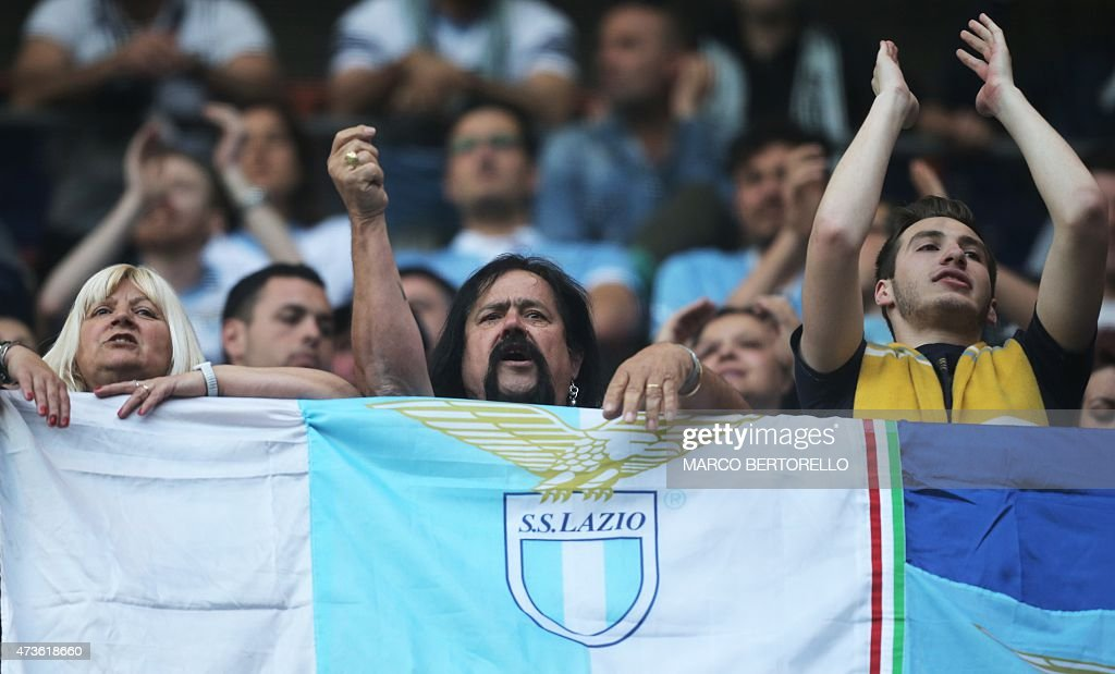 Lazio's supporters cheer before the Italian Serie A football match Sampdoria Vs Lazio on May 16, 2015 at 'Luigi Ferraris Stadium' in Genoa.