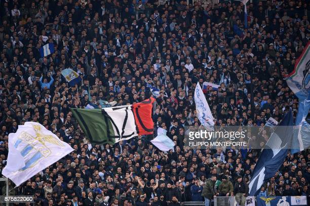 Lazio's supporters cheer during the Italian Serie A football match AS Roma vs Lazio on November 18 2017 at the Olympic stadium in Rome / AFP PHOTO /...