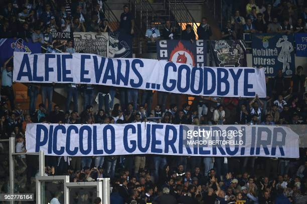 Lazio's supporters display two banners for Alfie Evans reading Goodbye Little Warrior during the Italian Serie A football match Torino vs Lazio on...