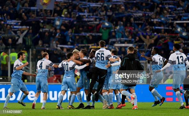 Lazio's team players and members of staff celebrate after winning at the end of the Coppa Italia final match between Lazio and Atalanta on May 15...