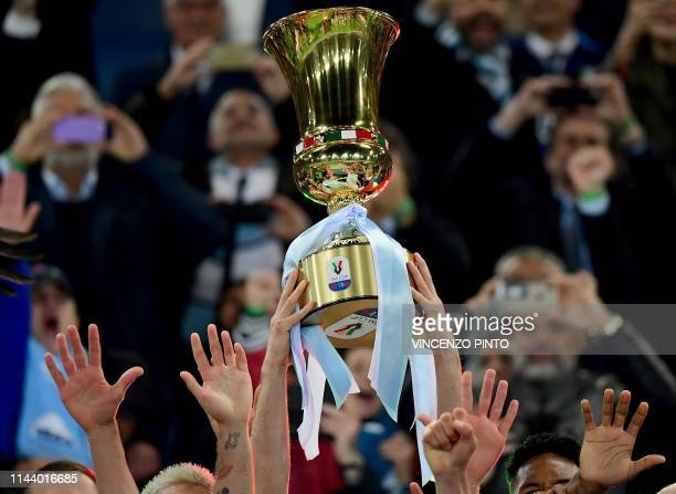 Lazio's team players celebrate as they hold the Tim Cup trophy during the trophy ceremony after winning the Coppa Italia final match between Lazio...
