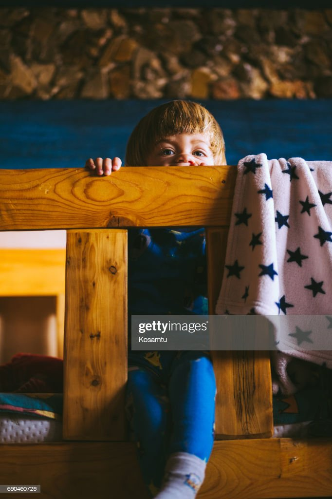 Lazy Boy Sitting On Bunk Bed Stock Photo Getty Images