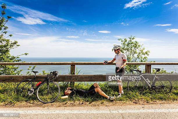 Lazy Cyclists Resting Along the Road During a Bike Race
