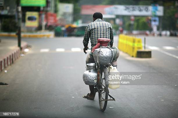 CONTENT] Lazy Friday afternoon and a milkman on a bike through the car windshield Laal Khan Bazaar Chittagong