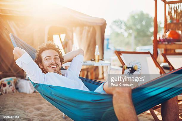 lazy summer afternoon - candid beach stock photos and pictures