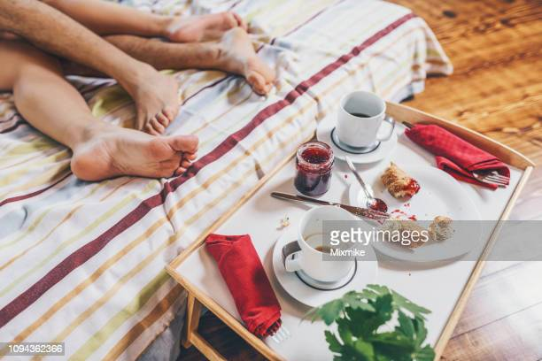 lazy weekend mornings - woman leg spread stock photos and pictures
