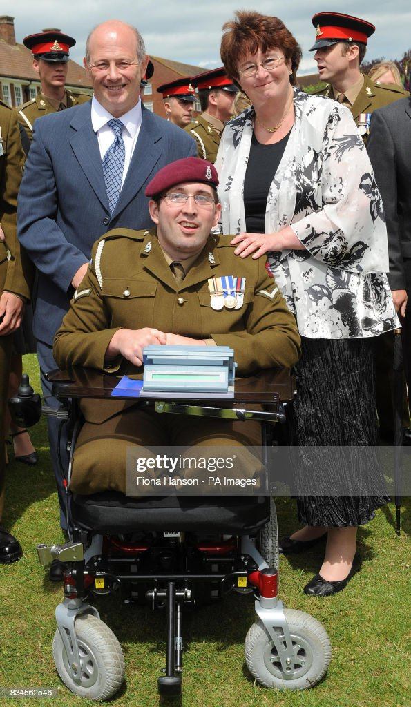 LBdr Ben Parkinson, 24, who lost both legs while serving with the 7th Parachute Regiment Royal Horse Artillery in Afghanistan with parents Diane Dernie and step-father Andrew at a garden party at The Royal Artillery Barracks in Larkhill, Salisbury.
