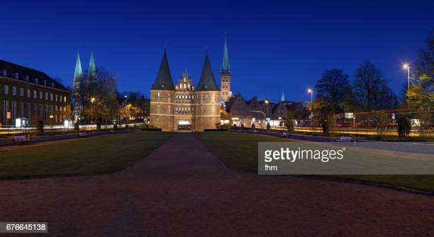 Lübeck, Holstentor at blue hour panorama (Schleswig-Holstein, Germany)