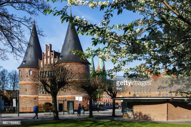 Lübeck, Holstentor - with cherry blossoms (Schleswig-Holstein, Germany)