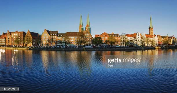 Lübeck skyline Panorama at Obertrave River (Schleswig-Holstein/ Germany)