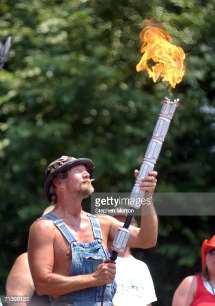 Bow, the official mascot of the Summer Redneck Games, lights the ceremonial torch to kick-off the 11th annual Summer Redneck Games July 8, 2006 in...