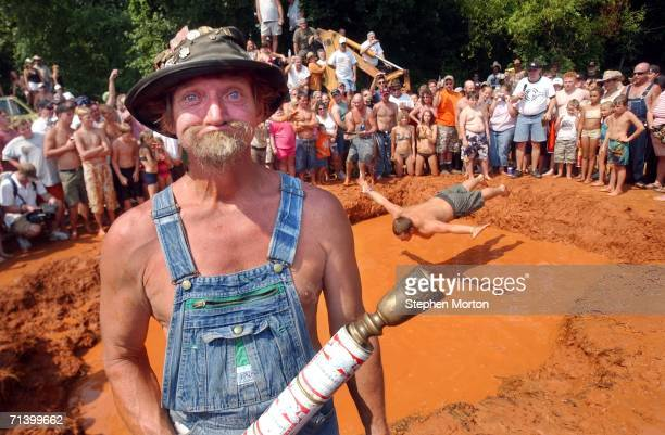Lbow the official mascot of the Summer Redneck Games poses next to the mud pit with the ceremonial torch during the 11th annual games July 8 2006 in...