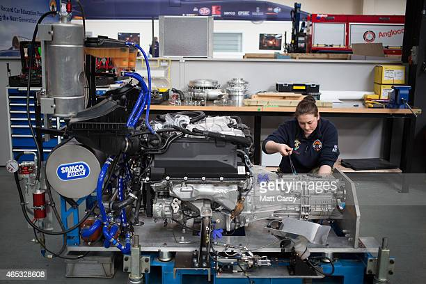 Cpl Kayleigh Williams from the Royal Electrical and Mechanical Engineers checks a Range Rover engine that will be also used in the Bloodhound SSC...