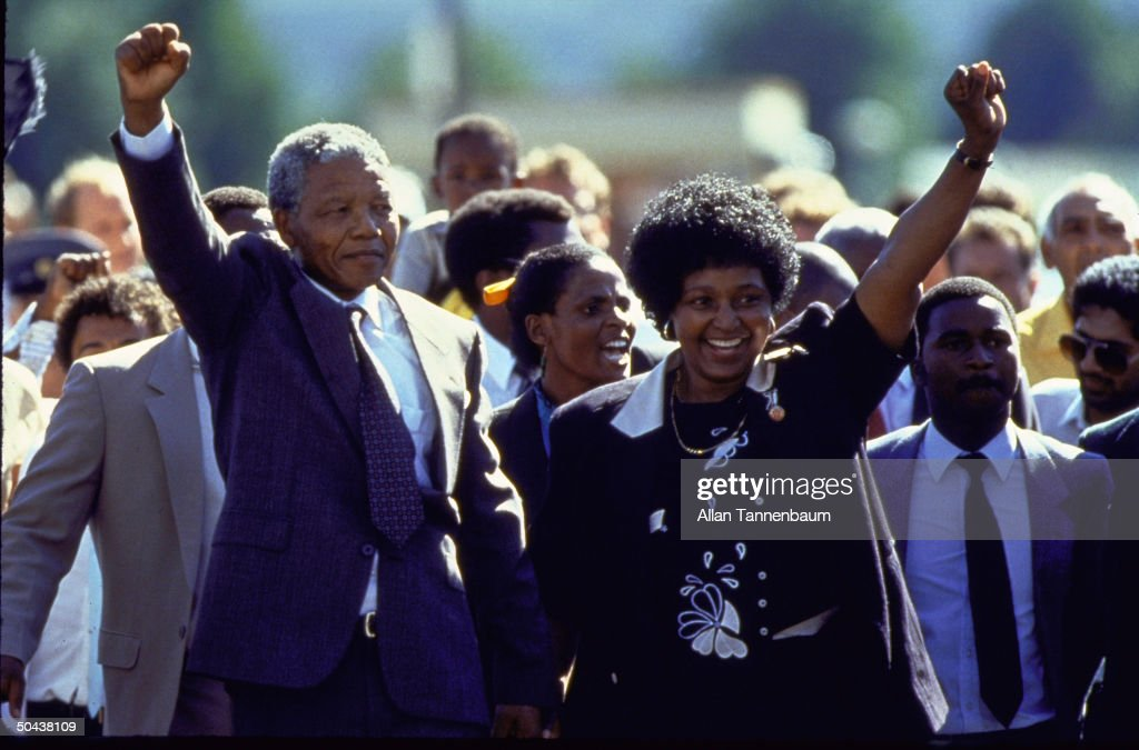 ANC ldr. Nelson Mandela and wife Winnie raising fists upon his release from Victor Verster prison after 27 yrs.
