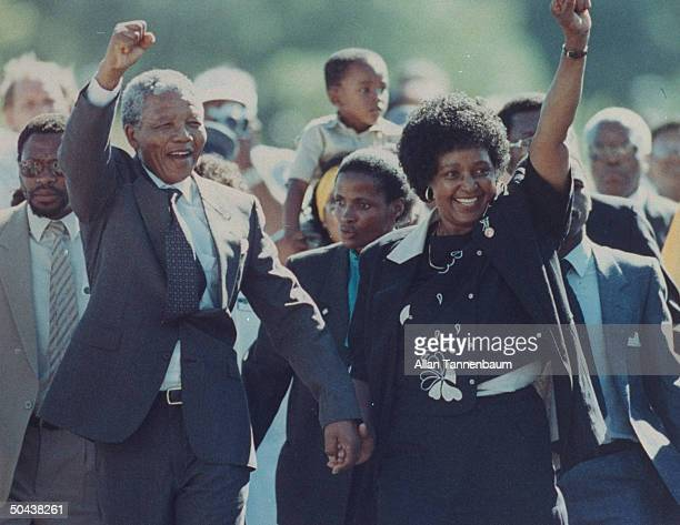 Ldr. Nelson Mandela and wife Winnie raising fists upon his release from Victor Verster prison after 27 yrs.