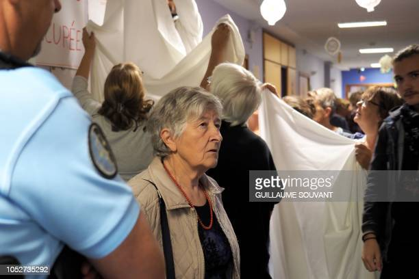 Le Blanc's mayor Annick Gombert talks with gendarmes as people occupy a corridor to protest against the closure of a maternity hospital in Le Blanc...
