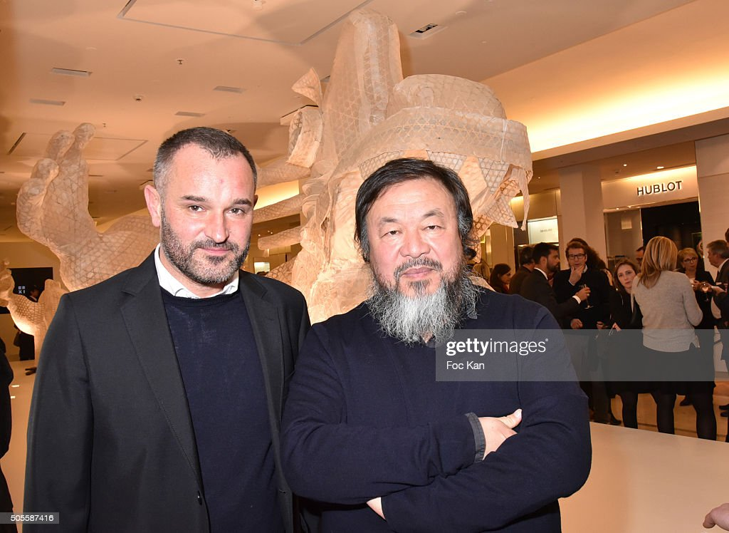 Le Bon Marche A.D. Frederic Bodenes and painter/sculptor Ai Weiwei attend the Ai Weiwei Exhibition Preview Cocktail at Le Bon Marche on January 18, 2016 in Paris, France.