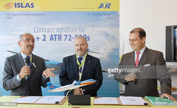 European aircraft manufacturer ATR Chairman of the Board Filippo Bagnato talks as Spanish company Islas Airways CEO Miguel Caceres and ATR CEO...