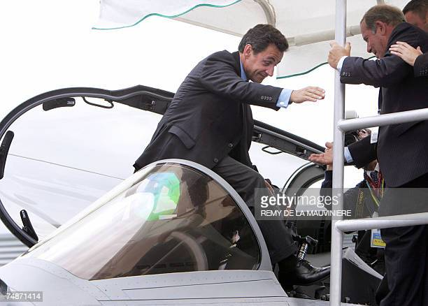 French President Nicolas Sarkozy steps out of the cockpit of a French Dassaultmade Rafale jet fighter during his visit at the 47th Paris Air Show in...