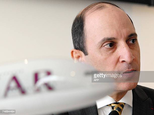 Qatar Airways Chief Executive Officer Akbar Al-Baker listens questions after signing a contract during the 47th Paris International air show at Le...