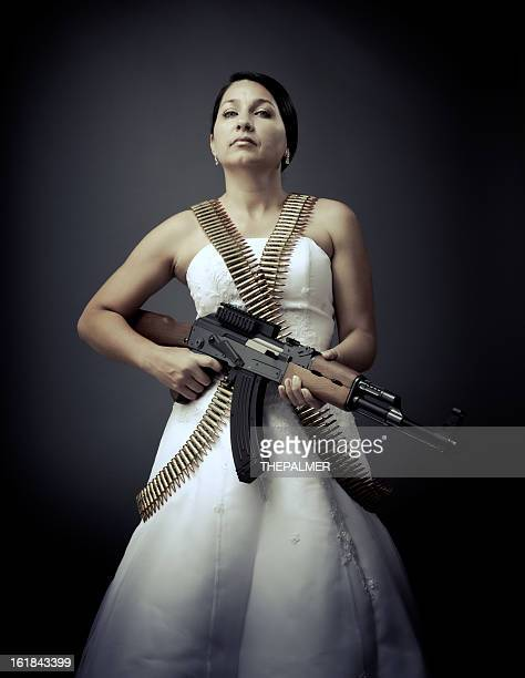 le bride fatale with an ak-47 - machine gun stock pictures, royalty-free photos & images