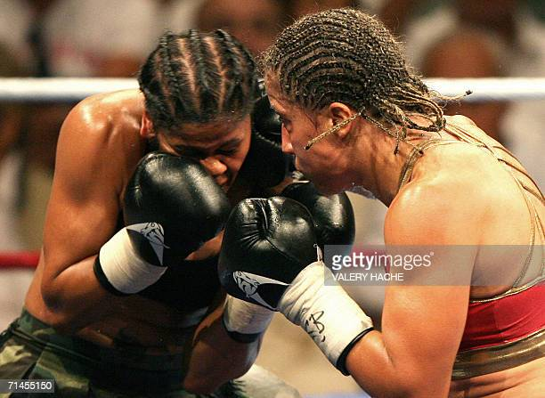 French boxer Myriam Lamare hits Puerto Rican Belinda Laracuente during their WBA Superlight weight world championship bout 15 July 2006 in Le Cannet...