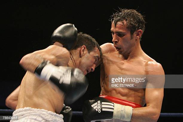 French Brahim Asloum fights with Argentinian Omar Narvaez during their WBO flyweight world championship fight, 10 March 2007 in Le Cannet, south...