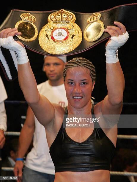 French world champion Myriam Lamare holds the superlightweight championship belt after winning a Women's World Boxing Championship match st Ivan...