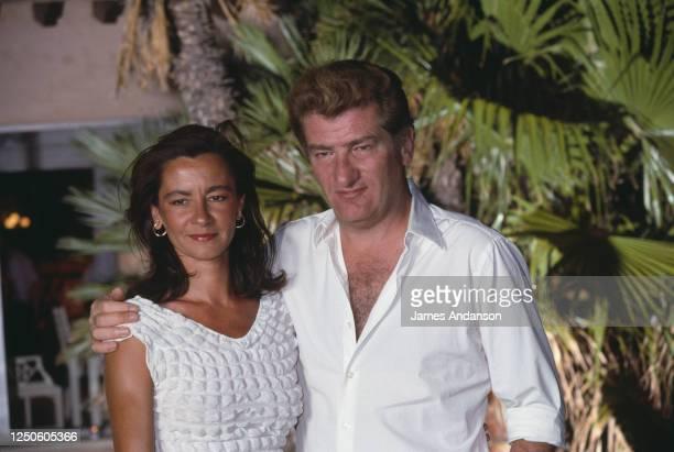 Le chanteur Eddy Mitchell et sa femme Muriel Bailleul à la soirée Eddie Barclay à Saint Tropez.