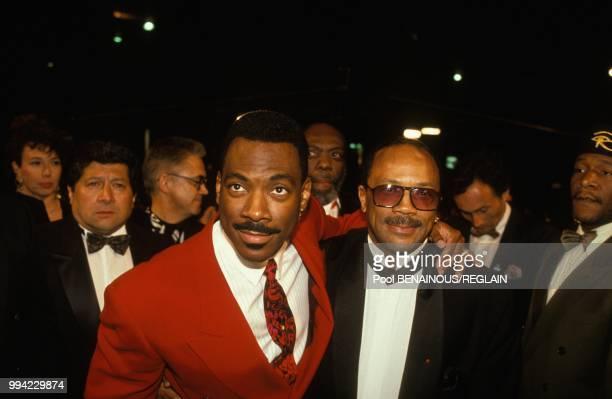 Le comedien Eddie Murphy et le musicien Quincy Jones a la soiree 'ln bed with Madonna' au Festival de Cannes le 13 mai 1991 a Cannes France