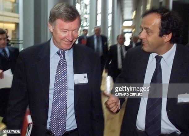 le conseiller du président de la Fédération internationale de football Michel Platini et l'entraîneur du club anglais Manchester United Alex Ferguson...