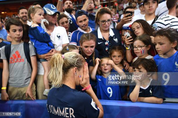 TOPSHOT le France's forward Eugenie Le Sommer reacts next to her fans at the end the France 2019 Women's World Cup quarterfinal football match...