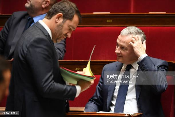 le French Economy Minister Bruno Le Maire gestures as French Junior Minister for the Relations with Parliament and Government Spokesperson Christophe...