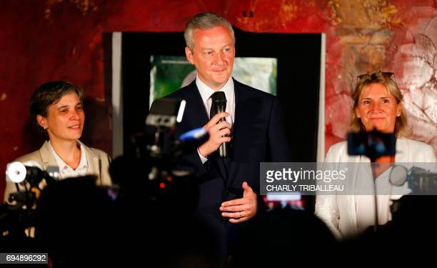 Le French Minister of Economy and parliamentary candidate Bruno Le Maire gives a speech between French Les Republicains party senator Nicole Duranton...