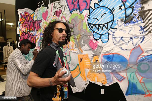 Le H and Reyz attend the Faith Connexion Street Art Tour hosted by Saks Fifth Avenue and Marie Claire at Saks Fifth Avenue on March 12 2015 in New...