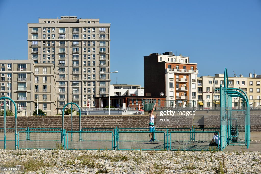 Le Havre (Normandy region, north western France): basketball court and buildings along the waterfront. Steeple of St. Joseph's Church. Buildings designed by architect Auguste Perret: The town centre of Le Havre is registered as a UNESCO World Heritage Site.