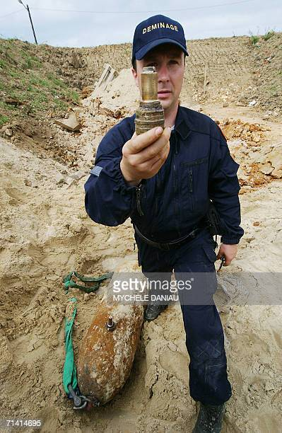 A mineclearing expert shows a detonator of a 250kilo british bomb dating from World War II after its disarming 11 July 2006 in Le Havre western...