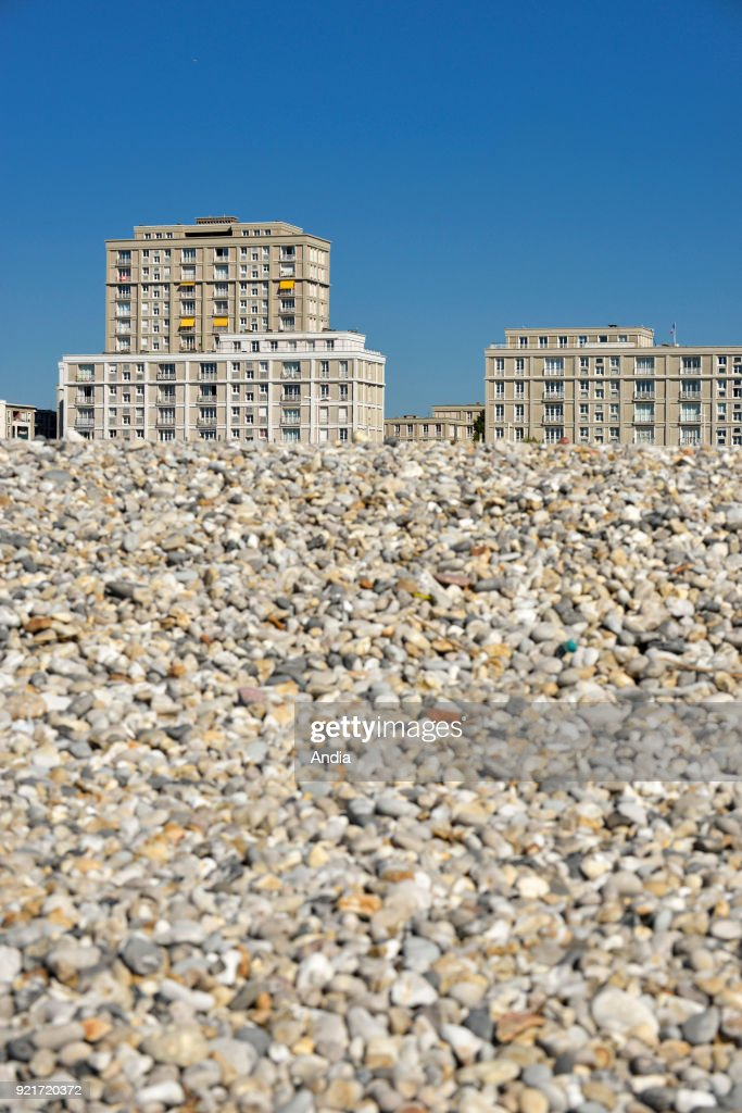 Le Havre (Normandy region, north western France): pebble beach and buildings along the waterfront. Buildings designed by architect Auguste Perret: The town centre of Le Havre is registered as a UNESCO World Heritage Site.