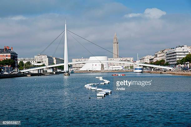 Le Havre the commercial port In the background the footbridge the concert hall named 'Le Volcan' and the tower of St Joseph's Church The town centre...