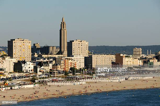 Le Havre the waterfront 'Porte Oceane' gate and SaintJoseph Church The town centre rebuilt during the postwar years by architect Auguste Perret The...