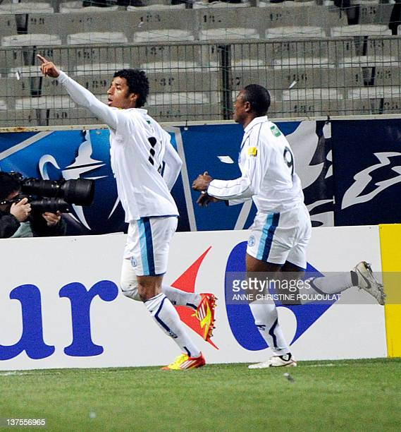 Le Havre's forward Ryan Da Graca Mendes celebrates with Paul Alo'o Efoulou after scoring a goal during the French Cup football match Marseille vs Le...