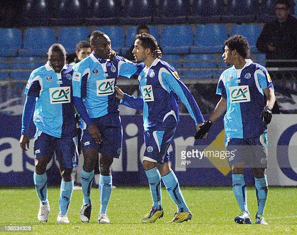 Le Havre's French forward forward James Fanchone is congratulated by his teammates Cameroonian forward Paul Alo'o Efoulou French defender Jonathan...