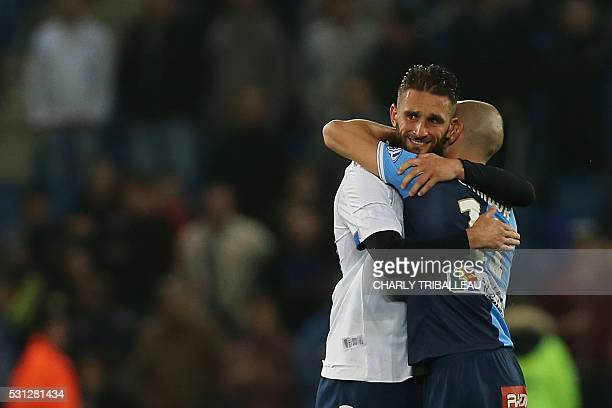 Le Havre's Ghislain Gimbert and Cedric Cambon react at the end of the French L2 football match between Le Havre and BourgenBresse on May 13 2016 at...