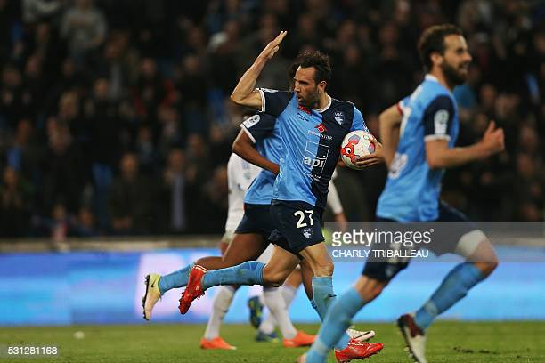 Le Havre's Ghislain Gimbert celebrates after scoring during the French L2 football match between Le Havre and BourgenBresse on May 13 2016 at the...