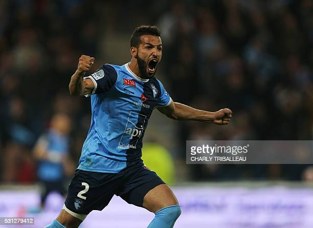 Le Havre's Issam Chebake celebrates after scoring during the French L2 football match between Le Havre and BourgenBresse on May 13 2016 at the Oceane...