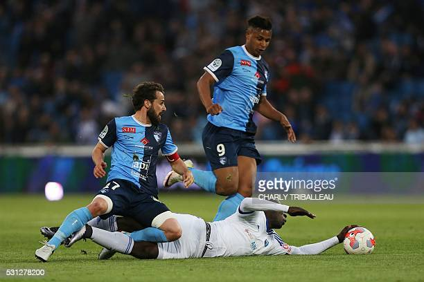 Le Havre's JeanPascal Fontaine and Lys Mousset vie with BourgenBresse's Vital NSimba during the French L2 football match between Le Havre and...