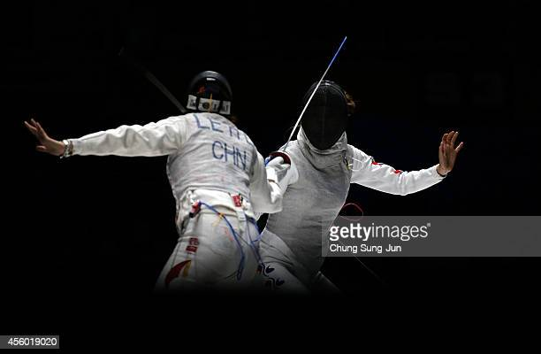 Le Huilin of China and Oh HaNa of South Korea compete in the Women's Foil Team Final during the 2014 Asian Games at Goyang Gymnasium on September 24...