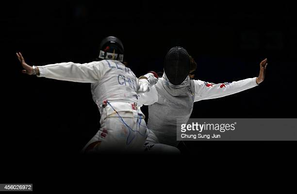Le Huilin of China and Oh Ha-Na of South Korea compete in the Women's Foil Team Final during the 2014 Asian Games at Goyang Gymnasium on September...