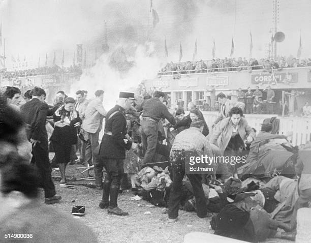 Le Mans Disaster Scene Le Mans France Police and bystanders frantically probe for survivors in the tangled heap of bodies and steel after a racer...
